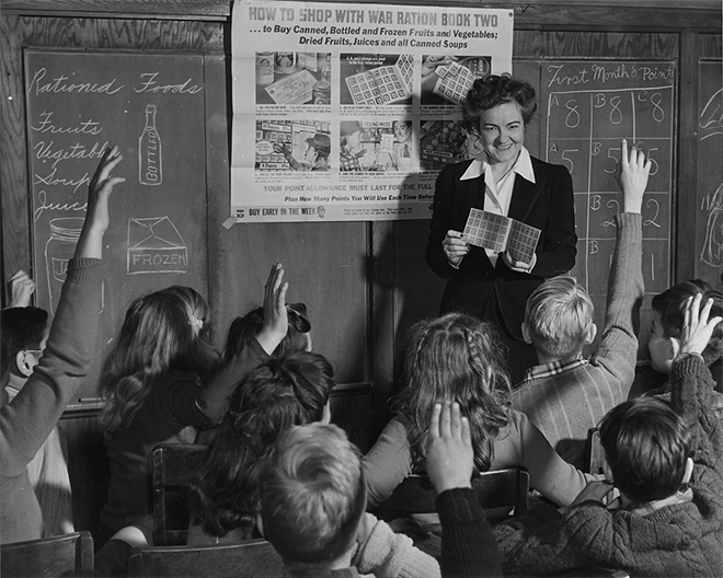 Catherine M. Rooney, 6th grade teacher instructs her alert pupils on the way and how of War Ration Book Two