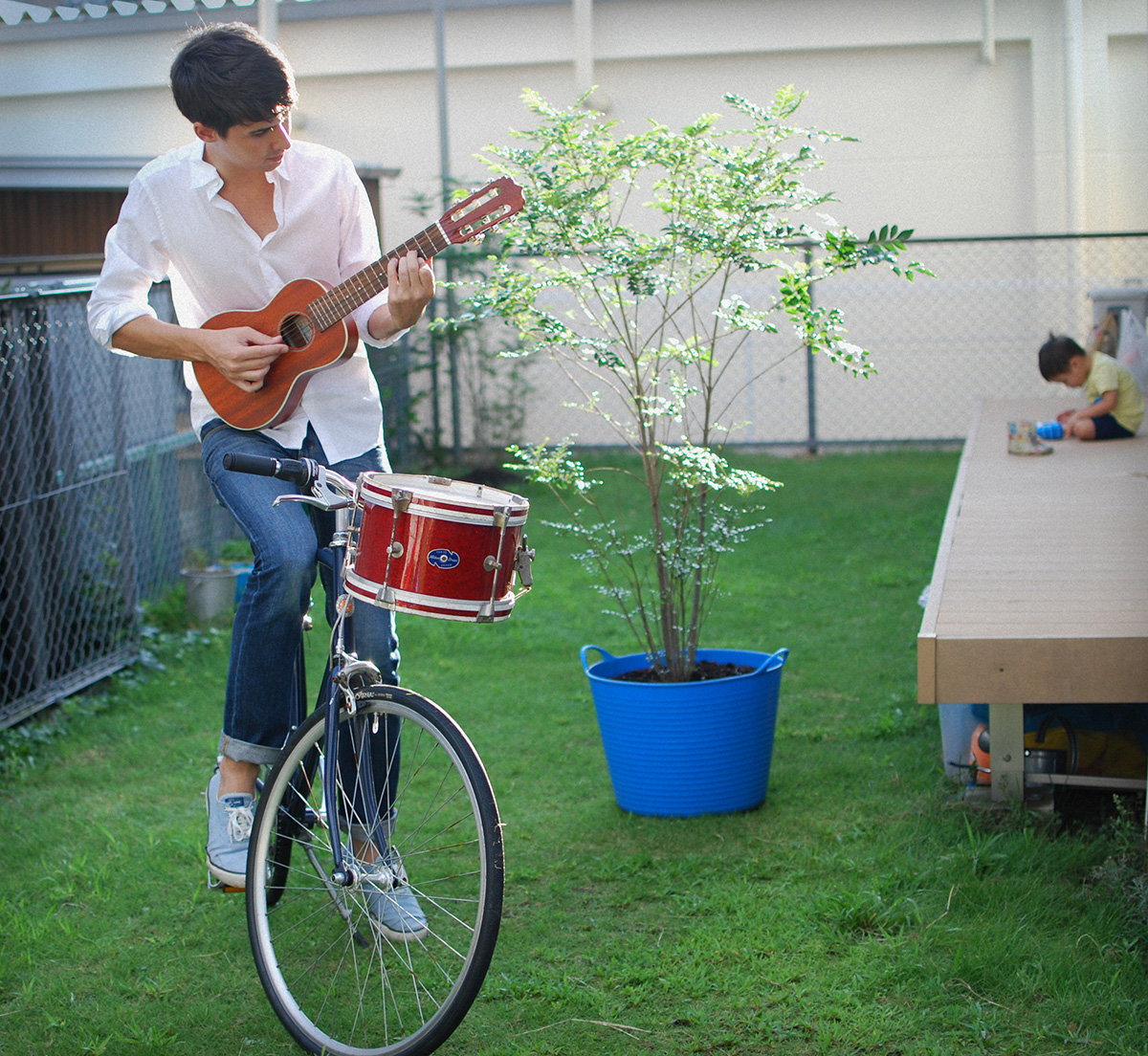 Lullatone: Shawn on the Bike with Drum and Guitalele